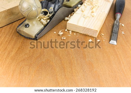 Carpenter??s working tools: plane and chisel with planks and shavings - stock photo