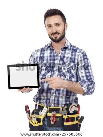 Carpenter showing tablet - stock photo