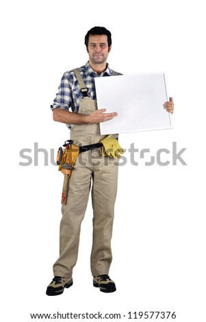 Carpenter stood with advertising panel - stock photo