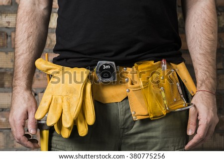 carpenter tool belt - stock photo