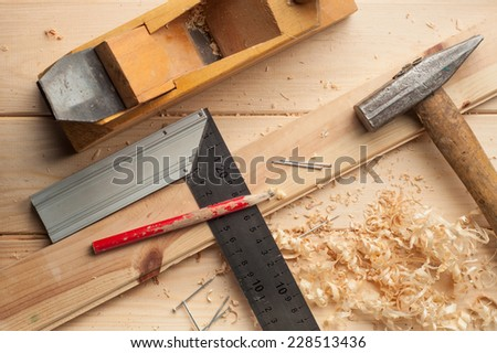 carpenter tools,hammer,meter, nails,shavings, and plane over wooden - stock photo