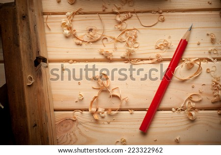 carpenter tools in pine wood table close up - stock photo