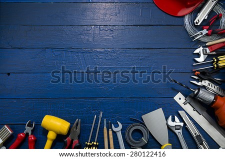 Carpenter Tools on Blue Wood - stock photo