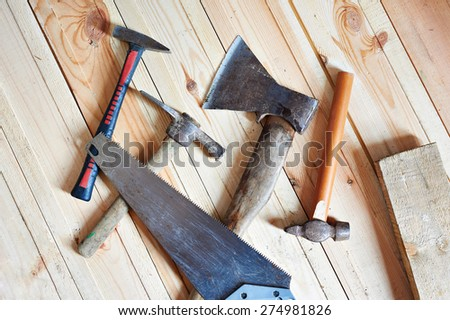 Carpenter tools on wooden boards closeup - stock photo
