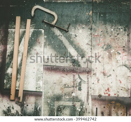 carpenter tools on wooden table in grunge color