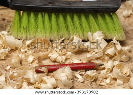 Carpenter tools on wooden table with sawdust. Carpenter workplace top view. - stock photo