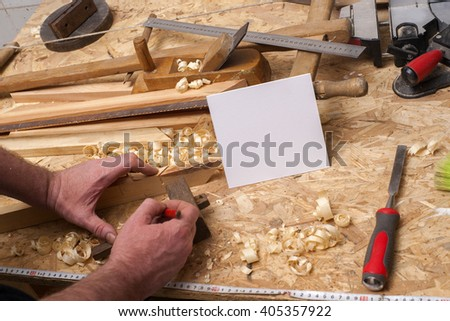 Carpenter tools on wooden table with sawdust. Carpenter workplace top view. Copy space for text. - stock photo