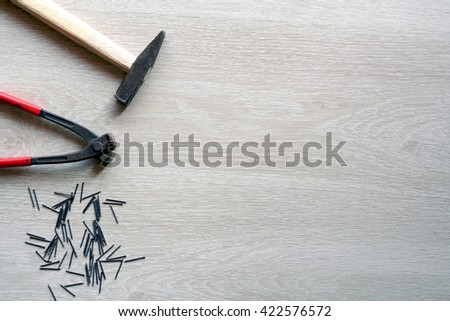 Carpenter tools with wooden background. Top view with copy space - stock photo