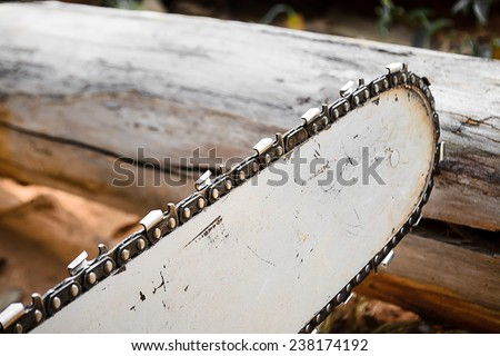 carpenter use Saw blade for cutting timber - stock photo