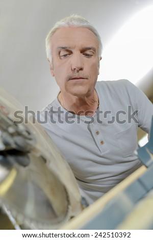 Carpenter using a circular saw - stock photo