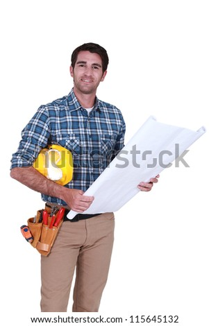 Carpenter with plans - stock photo