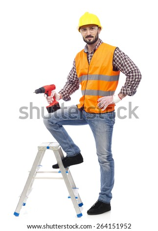 Carpenter with safety vest and drill - stock photo