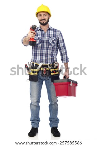 Carpenter with toolbox and drill - stock photo