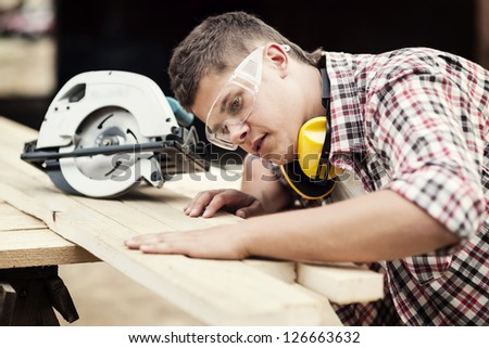 Carpenter working - stock photo