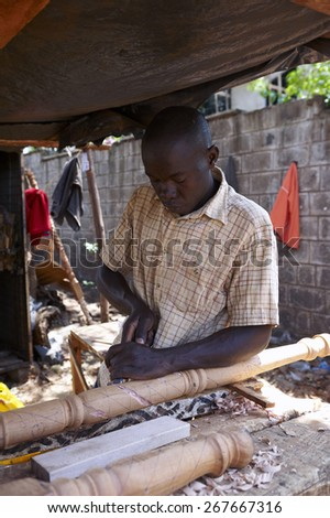 Carpenter working on a street in Nairobi (Kenya)
