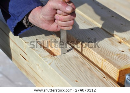 Carpenter working with chisel. - stock photo