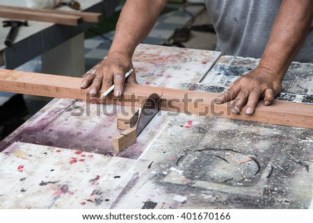 Carpenter working with Industrial tool in wood factory