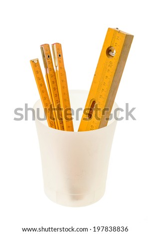 Carpentry and meter level in a bucket, isolated white - stock photo