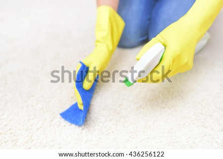 Carpet Cleaning spray. Close-up. Focus on the hand with a spray.