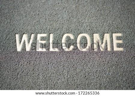 carpet welcome doormat background - stock photo
