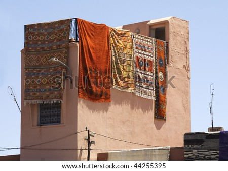 Carpets hanging from a roof in the Medina Marrakech - stock photo