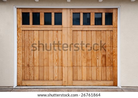 Carriage style garage doors of a contemporary home. - stock photo