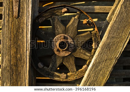 Carriage wheel, decorative detail from an old barn near Danube river in Serbia - stock photo