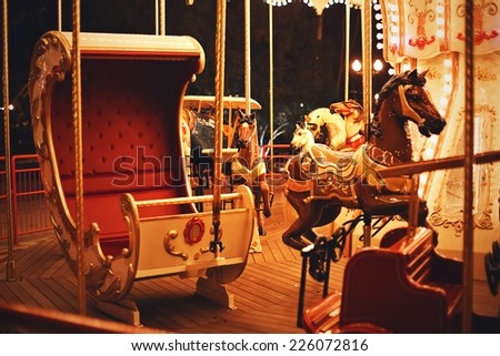 carriage with horse on carousel - stock photo