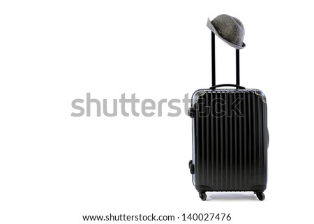 Carrier bag with hat and terrestrial globe - stock photo