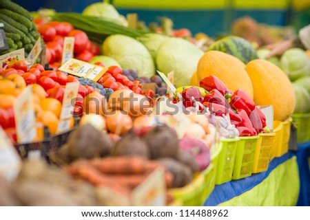 Carrot, beet root, onion, potatoes, tomatoes, melons on city market
