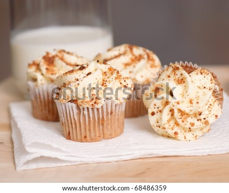 carrot cake cupcakes on wooden table - stock photo