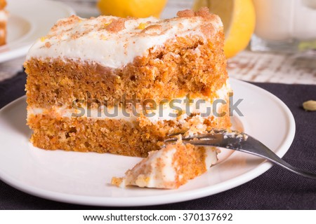 Carrot Cake on white plate with a fork.  - stock photo