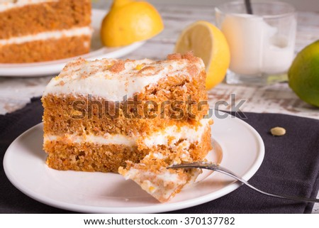 Carrot Cake with a fork.  - stock photo
