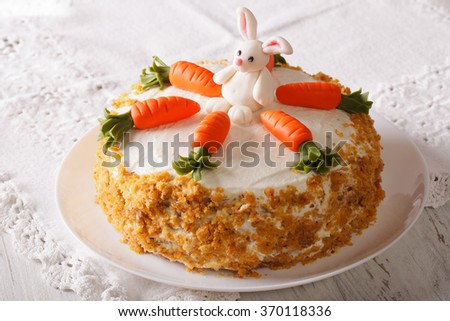 carrot cake with candy bunny close-up on a plate on the table. horizontal