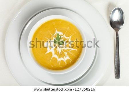 Carrot cream soup with croutons - stock photo