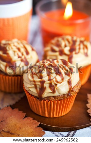 Carrot cupcakes decorated with cream cheese and caramel topping
