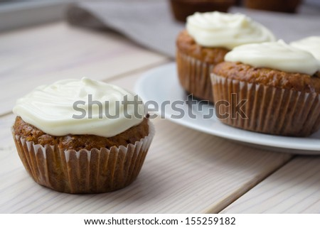 Carrot cupcakes with cream cheese - stock photo
