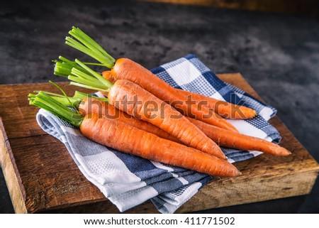 Carrot. Fresh Carrots bunch. Baby carrots. Raw fresh organic orange carrots. Healthy vegan vegetable food. - stock photo
