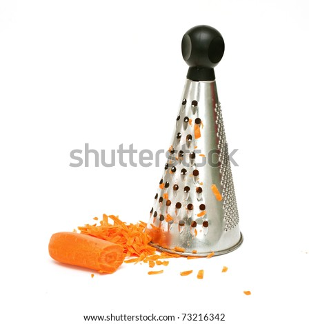 carrot grated on grater on white background - stock photo
