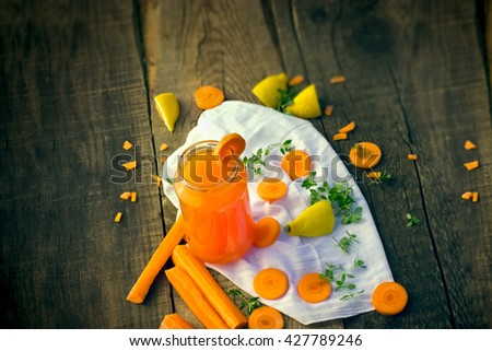 Carrot juice in jar - refreshing drink - stock photo