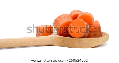 carrot sliced on wooden spoon isolated on white - stock photo