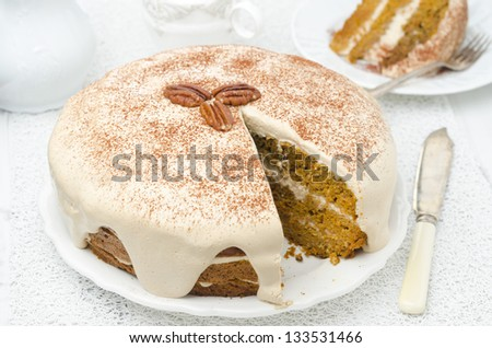 carrots and pumpkin cake with coffee cream in a cut on the plate - stock photo