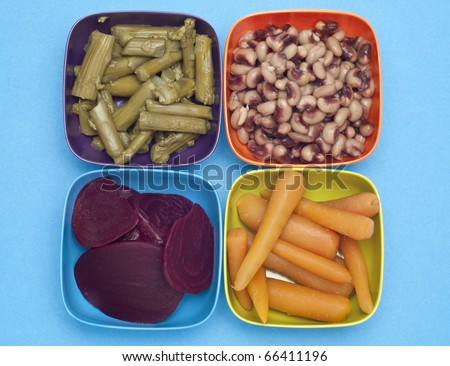 Carrots, Beets, Asparagus and Black Eyed Peas in Colorful Bowls.