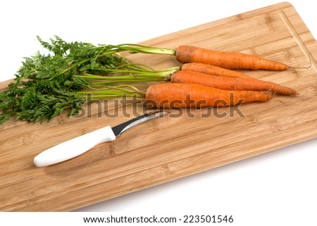 carrots on a wooden board