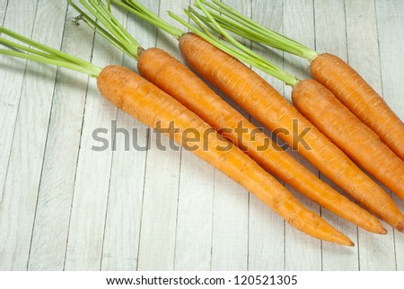 carrots on white wooden table