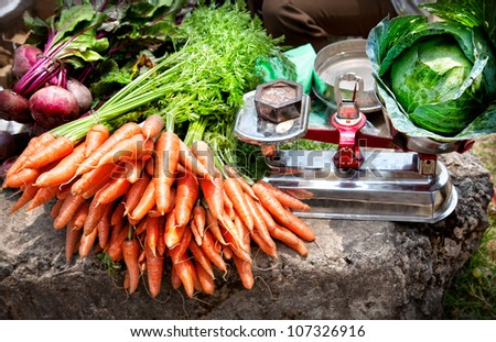 Carrots with leaves and beetroots near Cabbage on scales at the market, Kumly, Kerala, India - stock photo