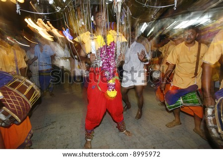 Carrying kavadi during Hindu festival of Thaipusam in Malaysia. - stock photo
