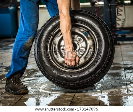 carrying tires - stock photo