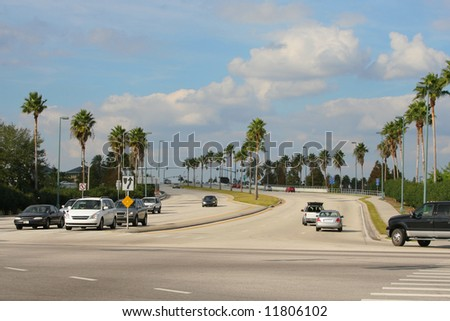 Cars at a crossroads - stock photo