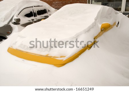 Cars buried deep in Snow Banks. - stock photo